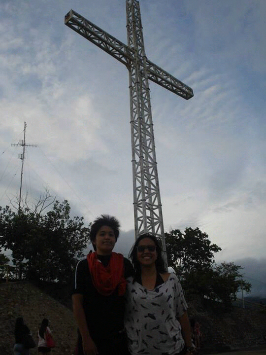 B and I with the famous Mt. Tapyas Cross at the back during our Coron Trip.  The cross was torn down by the recent Typhoon Yolanda :(