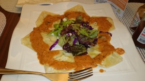 Our Ravioli stuffed with cream cheese and basil, sauteed in butter, topped with tomato sauce.  Delicious!