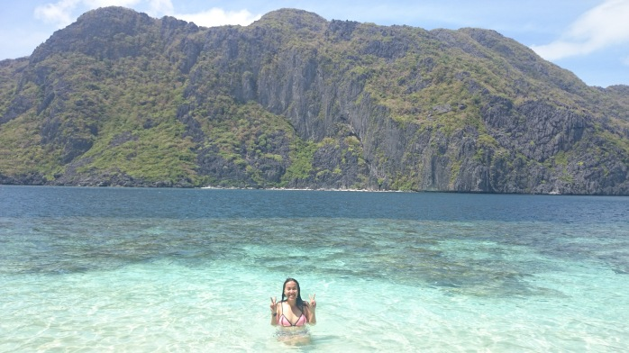 Enjoying the crystal clear water and fine white sand at El Nido, Palawan